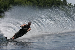 Waterskier on the Lake. Waterskier throwing a beautiful spray royalty free stock image