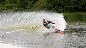 Waterskier skiing slalom Royalty Free Stock Photography