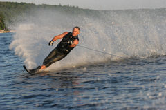 Waterskiing Man. Waterskier getting ready for the cut royalty free stock photo