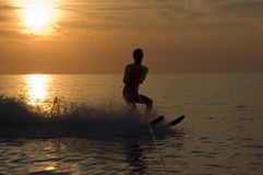 Waterskiing in the sunset. Sunset whit a man water skiing Royalty Free Stock Image