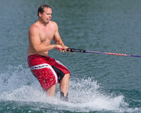 Waterskiing trick competition stock images