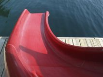 Waterslide. Red waterslide on a calm lake Stock Images