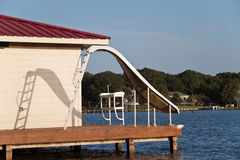 Waterslide. A waterslide on the end of a wooden dock Stock Image