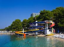 Waterslide and catamaran on beach Royalty Free Stock Photo