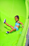 Waterslide fun. Little girl sliding down a water ride Royalty Free Stock Images