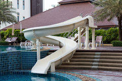 Waterslide near swimming pool Stock Photo