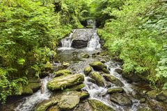 Watersmeet Devon UK. Hoar Oak Water, Watersmeet, just above its confluence with the East Lyn River, tumbling over rocks and with verdant river banks. Devon stock photography