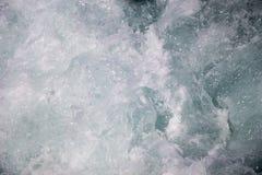 Waterspiegelachtergrond met schuim en bellen Royalty-vrije Stock Fotografie