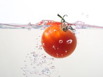 Watersplash del pomodoro Fotografie Stock