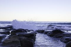 Watersplash on the rock on the ocean. Watersplash on the rock at the beach Royalty Free Stock Photo