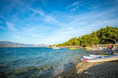 Watersport equipment on beach. Calm beach and watersport equipment in Croatia Royalty Free Stock Photography