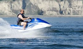Watersports. Action shot of man on seadoo Stock Photos