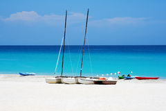 Watersports boats in a beach. Katamarans and water bicycles in a beach Stock Image