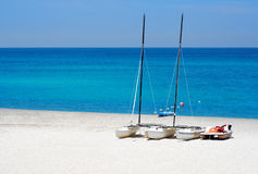 Watersports boats in a beach Royalty Free Stock Photography