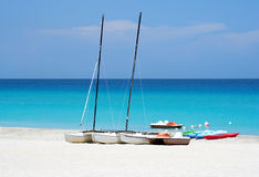 Watersports boats in a beach. Katamarans and water bicycles in a beach Royalty Free Stock Photography