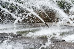 Waterspout fountainspits water in Summer. Stock Image