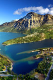 Waterton Lakes National Park Canada. Sweeping view over blue waters and rugged mountain peaks of Waterton Lakes National Park in Canada Royalty Free Stock Photography