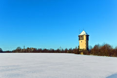 Watertower in  snow covered fields Stock Photos