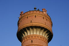 Watertower under blue sky Royalty Free Stock Image