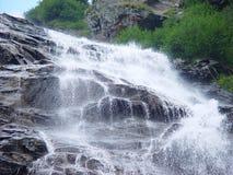 Waterval bij schemer Stock Afbeelding