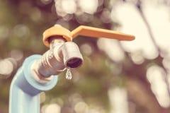 Waterverbruik en tekort stock afbeelding