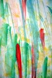 Waterverf abstracte achtergrond in gele rode groene tinten Stock Afbeeldingen