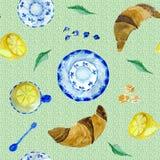 Waterverf naadloos patroon met thee, croissant en citroen stock illustratie