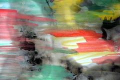 Waterverfslagen en gebrand document in rode groene tinten Stock Afbeelding