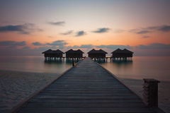 Watervilla at sunset Stock Image