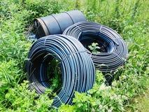 Watervoorzieningspijp in landbouwgrond Stock Afbeelding