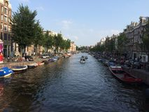 Waterway in Amsterdam, Netherlands. Beautiful scene from a bridge in Amsterdam on a clear day stock images