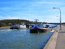 Cargo ships in canal Stock Photo