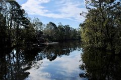 Waterway in Early Morning With Clouds Reflection Royalty Free Stock Photo