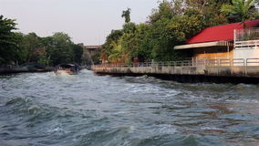 Waterway and fast speed riverboat ride in Bangkok, Thailand stock video footage