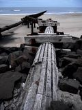 Waterway. Pipe leading onto a rocky beach into the sea Stock Images
