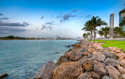 Waterway to Miami. View of waterway used to enter Miami Seaport with city in the background and recreational park at the side Stock Images