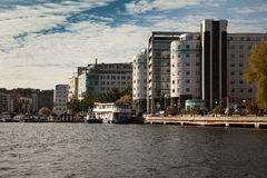 Waterways, boats and beautiful modern buildings in Stockholm, Sweden. Stock Photos