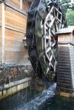 Waterwheel. A wooden waterwheel is rotating Royalty Free Stock Photo