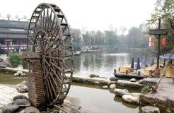 Waterwheel in china. Waterwheel in the riverside of huanglongxi ancient town in sichuan china Stock Photo