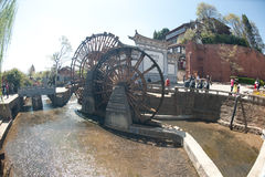 Waterwheel in Dayan ancient town in Lijiang,China. Royalty Free Stock Photos