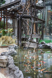 Waterwheel by the fish pond Royalty Free Stock Photos