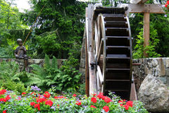 Waterwheel in a Flower Garden Stock Photo