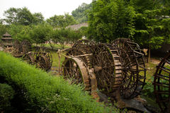 Waterwheel front of entrance to  Huanglong cave in China. Stock Image