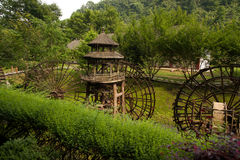 Waterwheel front of entrance to  Huanglong cave in China. Stock Images