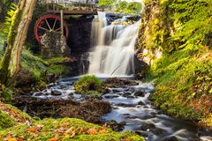 Waterwheel at a Glenariff is a valley of County Antrim, Ireland. stock photos