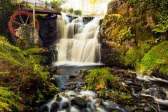 Waterwheel at a Glenariff is a valley of County Antrim, Ireland. royalty free stock photos