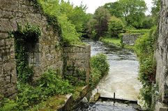 Waterwheel at Mill Bridge. Site of Waterwheel at Mill Bridge, River Fergus, Inchiquin Lough, Killinaboy, The Burren, Co. Clare, Ireland Royalty Free Stock Image