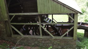Waterwheel with mill race, turning with sound stock video
