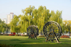 Waterwheel model in the park Stock Photography