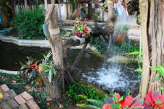 Waterwheel and pond in relax garden Royalty Free Stock Photos
